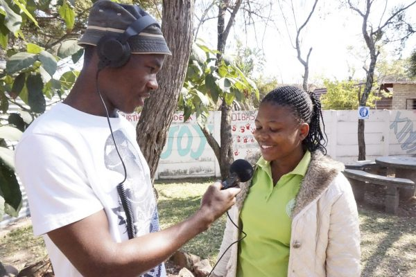Waterberg Wave reporter interviewing a WWS staff member